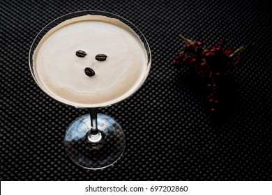 Espresso Martini Cocktail with coffee beans.
