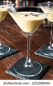 Espresso Martini Cocktail, vodka, kahlua, espresso coffee, in a Martini glass on wooden table