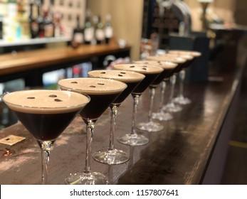 espresso martini cocktails in a long row