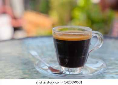 Espresso coffee​ on table in garden