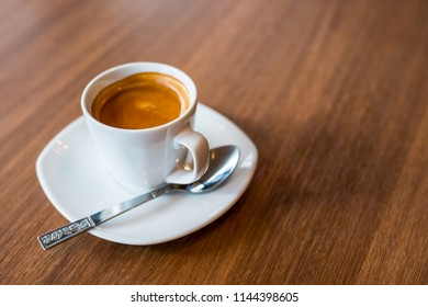 Espresso on the wooden table in cafe