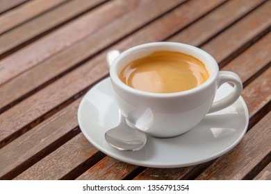 Espresso coffee​ on wooden table and morning light
