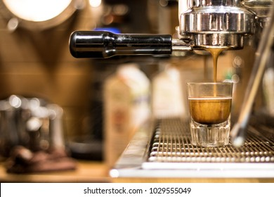 Espresso shot being brewed and poured.