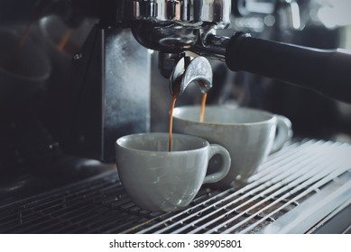 espresso shot from coffee machin in coffee shop vintage color