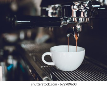 espresso shot from coffee espresso machine in coffee shop cafe