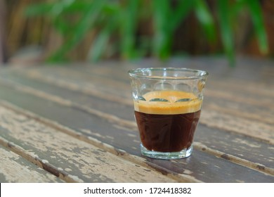 Espresso shot coffee on vintage table and natural background