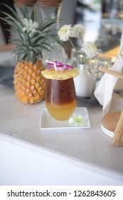Espresso shot with Pineapple Juice and Decoration with Pineapple Slice and Orchid Flower on top