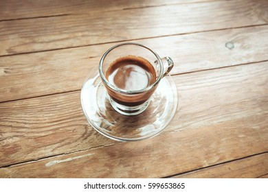 Espresso shot with wood table