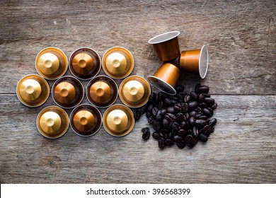 Espresso Single Shots in Various Colors with coffee bean on wooden background. Edit in dark color.