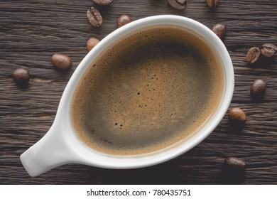espresso in stylish coffee cup on wooden table