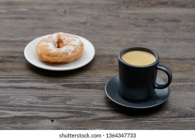 espresso with sweet donuts in sugar