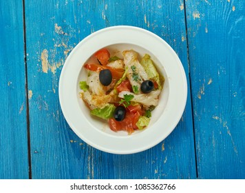 Esqueixada - traditional Catalan dish, a salad of shredded salt cod, tomatoes, onions, olive oil and vinegar, salt,