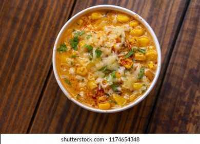 Esquite with corn, sauce, chili, onion, oil and mayonnaise.