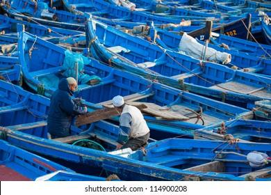 ESSAOUIRA, MOROCCO - MARCH 2: Unidentified fisherman preparing their boat for traditional art fishing in the fishing harbour of Essaouira, on March 2, 2012 in Essaouira, Morocco.