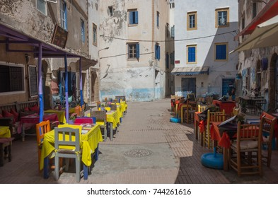 Essaouira, Morocco - May  6, 2017 :  Street cafe on square with colorful old houses in medieval medina of Essaouira, Morocco