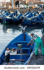 ESSAOUIRA, MOROCCO - NOVEMBER 4, 2015: Unidentified fishermen unloads a fish in the port on the coast of Essouira, Morocco.
