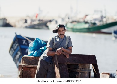 ESSAOUIRA, MOROCCO - NOVEMBER 4, 2015: Unidentified fisherman in the port on the coast of Essouira, Morocco.