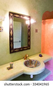 ESSAOUIRA, MOROCCO, SEP 2: Moroccan bathroom interior made with tadelakt Moroccan construction techniques. View of the sink, shower and the mirror with lighting equipment. Morocco 2014