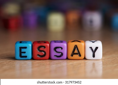 essay words with dices on wooden table