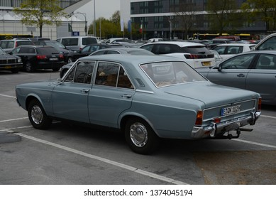 ESSEN, GERMANY - APRIL 12, 2019: Ford Taunus 17m P7 1700S popular family old 1960s German medium size car pictured on the street. Back car view.