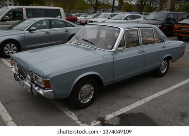 ESSEN, GERMANY - APRIL 12, 2019: Ford Taunus 17m P7 1700S popular family old 1960s German medium size car pictured on the street. Front view on the parking.