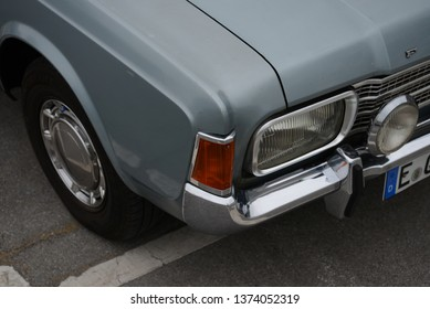 ESSEN, GERMANY - APRIL 12, 2019: Ford Taunus 17m P7 1700S popular family old 1960s German medium size car pictured on the street. Front view headlight.