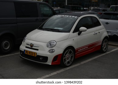 ESSEN, GERMANY - APRIL 12, 2019: FIAT 500 Abarth popular Italian compact sport style car pictured on the city street