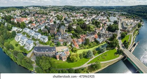 ESSEN / GERMANY - AUGUST 26 2016 : Skyline of Essen-Kettwig in the sun, aerial