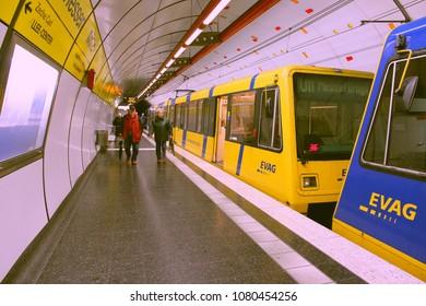 ESSEN, GERMANY - JULY 17, 2012: People wait at urban light rail station on July 17, 2012 in Essen, Germany. Essen Transport (EVAG) had 123.7 million rides in 2009.