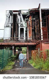 ESSEN, GERMANY - JULY 17, 2012: Person visits Zollverein in Essen, Germany. Former coal mine, now is listed as cultural landscape on UNESCO World Heritage List.