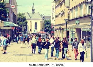 ESSEN, GERMANY - JULY 17, 2012: People shop downtown on July 17, 2012 in Essen, Germany. Essen is a city of almost 600 thousand citizens and was the 2010 European Capital of Culture.