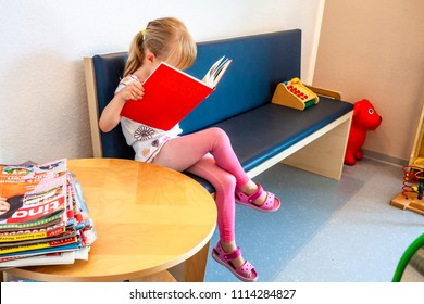 ESSEN / GERMANY - JUNE 11 2018 : Little girl patient waiting at Doctors Waiting Room.