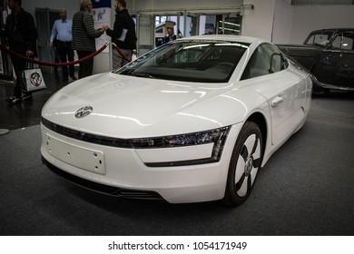 Essen, Germany, March 23, 2018; Essen Techno Classica 2018. White Volkswagen XL1. VW XL1.