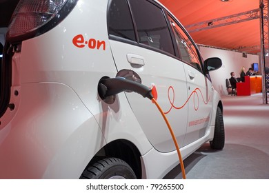 ESSEN, GERMANY - MAY, 5: An electric-car is charged at an E.ON-energy-service-station, shown on the General Meeting of Shareholders, May 5, 2011 in Essen, Germany
