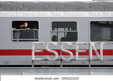 ESSEN / GERMANY - NOVEMBER 17th 2011: A man is looking out of the window of a German Intercity train. Directly in front of the carriage is the station name of Essen Hauptbahnhof (Main Station)