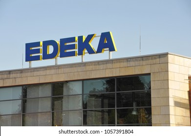 Essen, North Rhine-Westphalia / Germany - August 19, 2012: Logo on the roof of an EDEKA store in Essen, Germany  -  The EDEKA Group is the largest German supermarket corporation