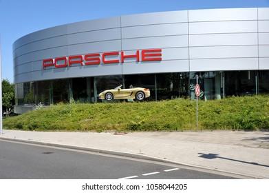 Essen, North Rhine-Westphalia / Germany - August 19, 2012: Porsche store in Essen, Germany - Porsche is a German automobile manufacturer owned by Volkswagen AG