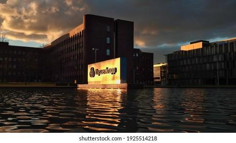 Essen, NRW, Deutschland, 02-26-2021 Thyssen krupp company logo in moving Water before sundown - headquarters Thyssen krupp AG, based in Essen, is a listed, diversified industrial group