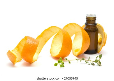 essence oil with orange peel and thyme, isolated on white