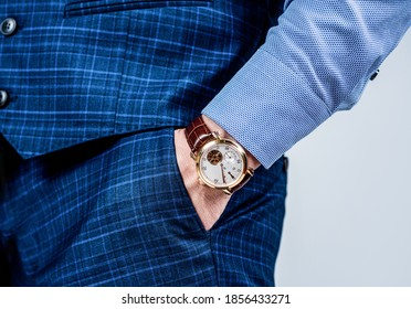 Essential accessory in any menswear collection. Luxury watch worn on male wrist. Classic timepiece. Fashion accessory. Trendy style. Punctuality and promptness. Current time.