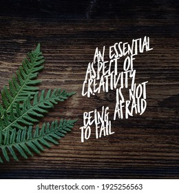 An essential aspect of creativity is not being afraid to fail, best and meaningful quote for motivating life, green plant on wood background