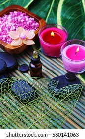 essential oil with bath salt and candles - beauty treatment