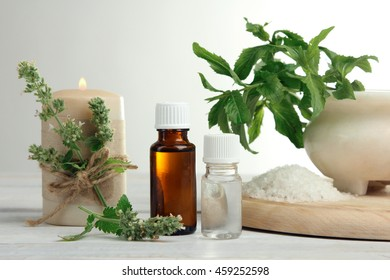 essential oil with bath salt on white wooden background.The concept of aromatherapy