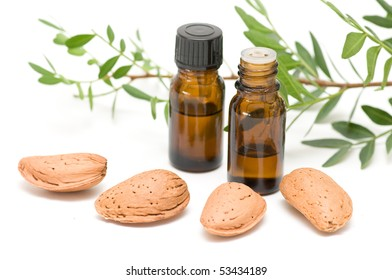 Essential oil bottles arrangement isolated on white