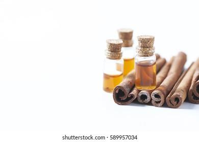 Essential oil cinnamon in glass bottle. Spa concept. Selective focus.