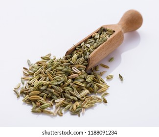 essential oil of fennel seeds on a white background