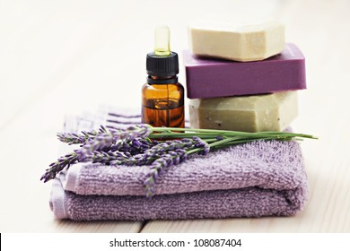 essential oil with lavender flowers - health and beauty