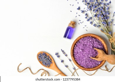 Essential oil and lavender salt with flowers . Flat lay, top view, copy space.