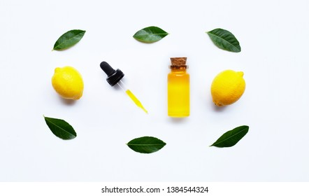 Essential oil with lemon on white background.