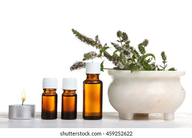 essential oil with Melissa on a white isolated background.The concept of aromatherapy
